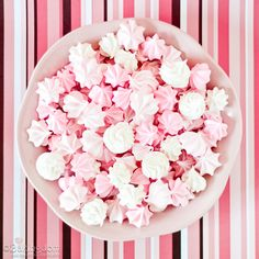 A bowl bursting with scores of sweet little Raspberry Meringue Kisses