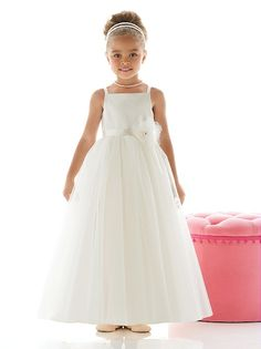 Flower girl dress has matte satin bodice with spaghetti straps and ballerina tulle skirt. Hand worked flower detail with rhinestone center at empire waist. Fabric and colors match many of our bridesmaid dress styles.