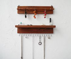 Set: necklace holder shelf + bracelets holder / tan wood dark walnut solid wood This hand crafted organizer adds a touch of rustic charm to your room. Has 15 hooks this organizer is 15,3 long Each jewelry organizer has hooks mounted on the back for easy hanging on your wall. NOTE: