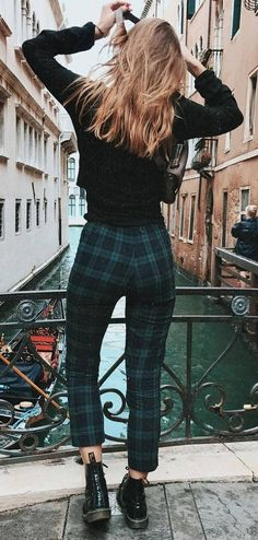 fall outfit idea : black top + plaid pants + boots