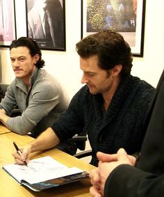 Sweater.. forearms... can't breathe! Richard signing autographs