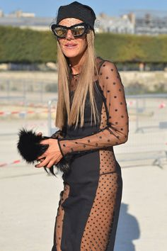 Anna Dello Russo wears a Stella McCartney dress and Jil Sander hat.