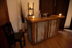 Home bar made with reclaimed barn wood and  corrugated metal barn roofing