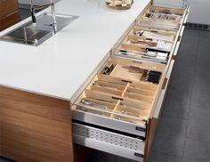 SANTOS kitchen   Santos's standard: optimising space. Santos has a standard 81 cm high base unit with 60 cm deep drawers that can support up to 65 kgs. This allows for more storage space, offering up to 20% more capacity than the standard market 50 cm drawer.