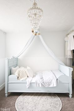 The most serene color palette, fit for any little princess. Must see the charming details of this blue and white girls bedroom makeover. #cottagestyle #farmhousestyle #frenchfarmhouse #blueandwhite #girlsbedroom #makeover #camitidbits #germansleighbed #cottage #farmhouse #girlsroom