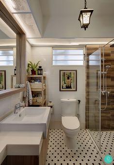 We love the interesting use of polka dot tiles in this bathroom. #honeycombtiles #bathroomtiles #lantern