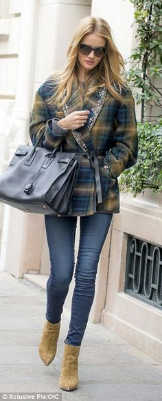Parisian chic: The model immediately got to work and was seen strolling through the city a...