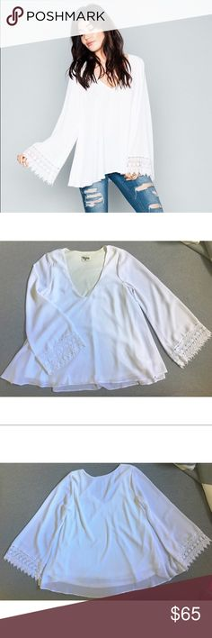 Show Me Your Mumu Mal Top White Crisp EUC Show Me Your Mumu Mal Top in White Crisp, Size Medium! Super cute flowy top with lace detail on the sleeves. Lined with cream fabric. Small run in the chiffon on the back of the top but it is hardly noticeable at all! Picture of run included! Can be worn with jeans or tucked into a skirt! Measurements: Front Shoulder Seam to Bottom 27in; Back 27.5in; Sleeve Seam to end with lace 24.5in Show Me Your MuMu Tops Blouses