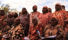 The Central Australian Aboriginal Women's Choir perform at the celebration of the 30th anniversary of the return of Uluru and Kata Tjuta to the Anangu people
