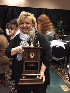 Director Pattye Archer with the trophy for Best Production for SCT's production of Vanya and Sonia and Masha and Spike at the 2017 MTA Festival.