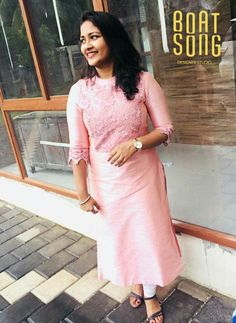A lovely baby pink laced in the most feminine fashion. Caressing every bit of the woman in you. Salwar Suit Neck Designs, Kurta Neck Design, Kurta Designs Women, Dress Neck Designs, Salwar Designs, Kurti Designs Party Wear, Blouse Designs, Pink Kurti, Churidhar Designs
