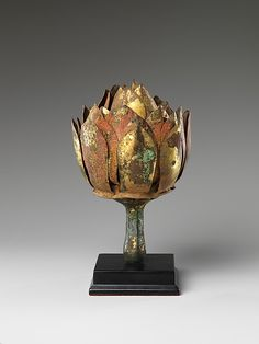An ancient Chinese gilt-bronze lotus, a symbol of purity, perfection and more. (Metropolitan Museum of Art)