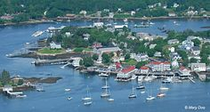 Boothbay Harbor, Maine ~  Start at the top left of the pic - and count over 4 houses to the right.  The white house up between and above two gray houses is Cape McKay (our house!).