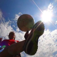Soccer facing up into the sun