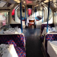Dinner on a decommissioned Victoria Line train.  Underground London.