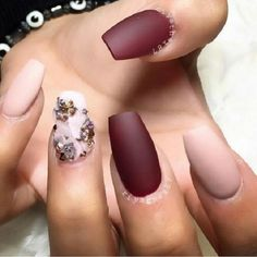Simple and stunning maroon nail art design with nude polish. The combination of the maroon and nude polish makes the design look elegant but also soft with the help of flower-shaped embellishments on top.
