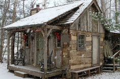 tiny cabin in the woods with first snow fall.Ever since I was a little girl I dreamed of living in a wood cabin,with a very rustic interior. These tiny homes make it so dreaming of owning your own wood cabin is possible.