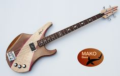 "MAKO BASS 34"" scale - neck through: hard maple/purpleheart - walnut body semihollow, curly maple fin, ebony inlay - neck with carbon rods reinforcement,  rosewood fingerboard, MOP inlay, pickup langcaster humbucker active  12 magnet poles - built-in overdrive - 3d-4 bridge from schaller   machines from groover"