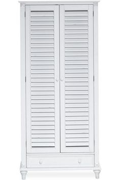 A bookcase with shutter doors adds character while providing storage. HomeDecorators.com