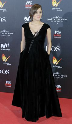 For the Madrid premiere of  Allied , Marion Cotillard dazzled in a custom Giorgio  Armani Privé black silk velvet gown with crystal bow-detail. a87a3c0b184