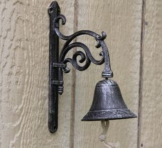 Cast Iron Decorative Garden Bell This cast iron bell will add a unique touch to any garden area, backyard, porch... Made of Cast iron it is both beautiful and strong. Painted with a silverfish black t