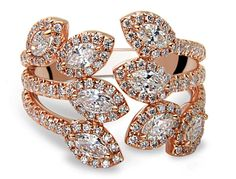This Bands of Love Multi Marquise Ring by De Hago is a stylish way to bring in the fall foliage. Eight marquise-cut diamonds make up this floating ring, complementing each line of the diamond-lined branches. The ring is set in 18k rose gold, featuring 0.77 cts. t.w. marquise diamonds and 1.02 cts. t.w. round diamonds. www.diamonds.pro
