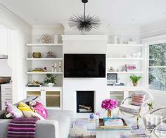 white and pink living room, pink accents, tv