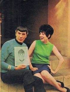 Spock holding a Spock fanzine while sitting next to a Spock fangirl. This would be me! Haha!