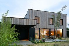 "Timber-framed ""bioclimatic"" house with larch cladding by Tectoniques"