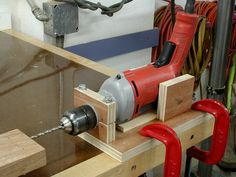 I needed to drill some fairly accurate holes in the ends of a long board. So I made this jig to hold my drill in a horizontal position. I was careful to make the center line of the drill parallel to the edge of the base. Woodworking As A Hobby, Woodworking Workshop, Easy Woodworking Projects, Woodworking Jigs, Woodworking Techniques, Woodworking Furniture, Drill Jig, Drill Guide, Diy Workshop
