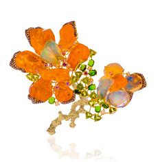 Lugano Diamonds flower brooch, rough fire opal, and mixed opal cuts, gold setting