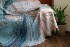 """Variegated, soft and cozy blanket (throw) of original design and patterns, best to cover a couch, a sofa, or an arm-chair. This Yaga cover will make your home more attractive and cozy. Size: 200x150 cm (79""""-59"""") Materials: wool – 70%, acrylic – 30%"""