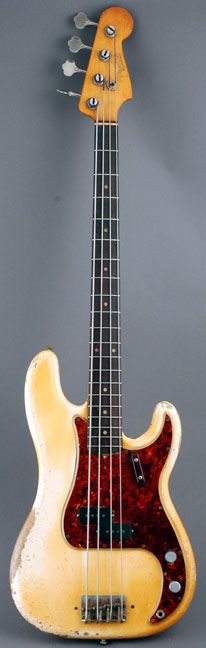 Well played 1963 Fender Precision in Olympic white that has yellowed with age.