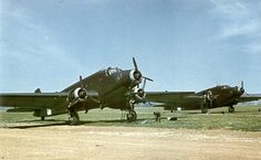 On an unidentified Italian airfield, late 1942 or early 1943, two of the Italian classic transport aircraft (the other was the Fiat G.12) of World war II, both Savoia-Marchetti: on the left the SM.75 and, on the right, the SM.82, during an engine maintenance.