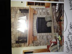Like our fireplace with rustic log mantle instead...Marsh Hearthstone and Taupe Trimstone with Chardonnay Country Ledgestone (pic from product selection guide p. 15). Culturedstone.com