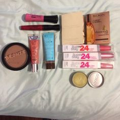 Lipstick  Eyeshadow sea salt spray bundle  3 Brand  long wear color stay liquid lipstick. ( Retails at $9 each)  2 swatched lip glosses in red & pinkish  1 brand new eyeshadow from cargo color ( Green Bay) . Swatched with finger only .  1 new bronzer ( too dark for me, never used )  1 tan n' go bronzer 'gel bronzant'   2 travel size bottles of LA playa sea salt spray NEW   1 brand NEW trio compact eyeshadow from NYX   TOTAL = 11 make up items . All new. Some barely swatched Accessories
