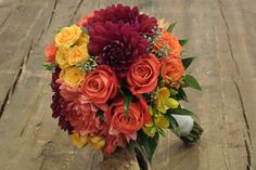 Bridal bouquet with orange,red and yellow. Roses,Dahlias and skimmia. Forget-Me-Not Flowers, Banff