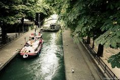 The Seine isn't the only stream of water in Paris: You can also walk along the very pretty canal Saint Martin and observe the quaint barges while Parisians play pétanque or have wine and cheese picnics by the water. Oh The Places You'll Go, Places To Travel, Places To Visit, Paris Travel, France Travel, Paris France, Pont Paris, Paris 2015, Photos Voyages