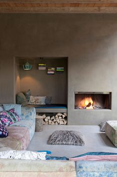 Love this 'natural concrete' style wall with its integral fireseat and fireplace…  The various textures look fabulous here