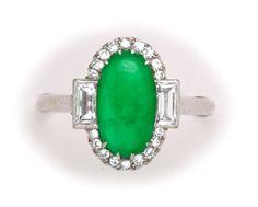 Fine jadeite, diamond and platinum cluster ring.