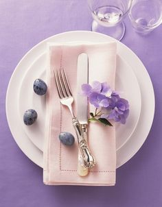 Set the Table for Spring.  Lavender/Purple and Coral/Orange are suppose to be the go to colors for Spring 2012.  This is a lovely interpretation for a table top display.