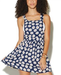 Daisy Print Overall Skirt  | Wet Seal, this would be super cute Wyeth a white t shirt.