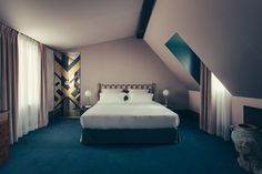 Art Deco patterned mirror with pink purple and green decorated bedroom suite -  Art Deco inspired designs of the Hotel Saint Marc luxury boutique hotel in central Paris, France. Retro Interior Design inspiration and images from the hotel featured on the Martyn White Designs Blog