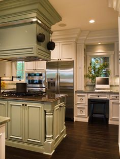 built in office area. in the kitchen? this is actually, a great idea. bills accumulate in the kitchen anyway.