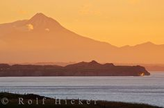 Photo of Mt. Taranaki or Mt. Egmont during a beautiful sunset over the coastal scenery of the West Coast, North Island, NZ.
