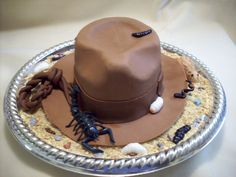 .  Fondant scorpion, rat, and slugs. RI black bugs. Chocolate rocks, and crushed graham crackers.TFL!