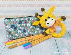 Giraffe baby rattle crochet pattern designed by Amigurumi Today