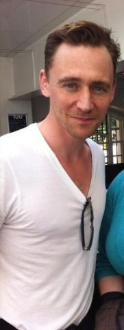 Tom Hiddleston...still sexy as hell in a plain white T-shirt.