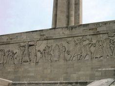 "The Great Frieze by Edmond Amateis  (depicting man's journey from war to peace)  on the north wall has an inscription that reads ""These have dared bear the torches of sacrifice and service. Their bodies return to dust but their work liveth evermore. Let us strive on to do all which may achieve and cherish a just and lasting peace among ourselves and with all nations."