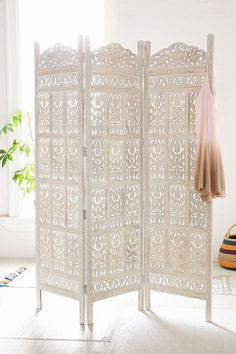 Urban Outfitters Amber Carved Wood Room Divider Screen Intricately carved wooden screen in a tri-fold silhouette. This sturdy standout piece works perfectly as a room divider. Only at Urban Outfitters. Room Divider Diy, Room Divider Screen, Divider Ideas, Room Divider Headboard, Folding Room Dividers, Dividers For Rooms, Decorative Room Dividers, Divider Design, Shabby Chic Room Divider